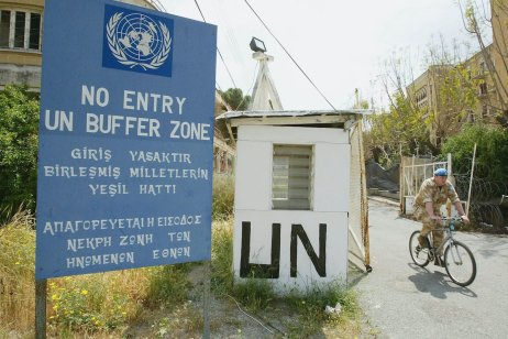 A United Nations worker rides his bike through the UN Buffer Zone that seperates the Turkish and Greek sides of Nicosia on April 24, 2004 in Nicosia, Cyprus [Scott Barbour/Getty Images]