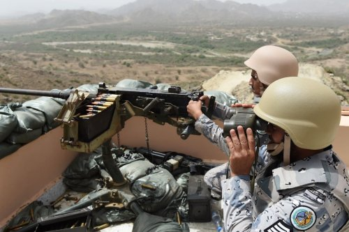 Members of the Saudi border guard are stationed at a look-out point on the Saudi-Yemeni border, in southwestern Saudi Arabia, on 9 April 2015. [FAYEZ NURELDINE/AFP via Getty Images]