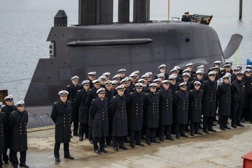 Sailors of the German Navy stand to attention during the launch of a new U36 submarine at the Eckerfoerde German Navy base on October 10, 2016 in Eckernfoerde, Germany. [Morris MacMatzen/Getty Images]