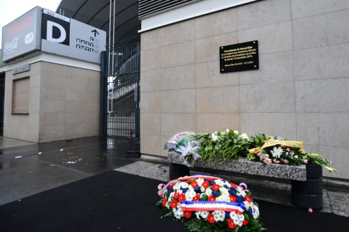 The commemorative plaque unveiled by French President Francois Hollande and Saint-Denis Mayor Didier Paillard is seen outside the Stade de France stadiumon the first anniversary of the 2015 Paris terrorists attacks on November 13, 2016 in Saint Denis, France. [Frederic Stevens/Getty Images]