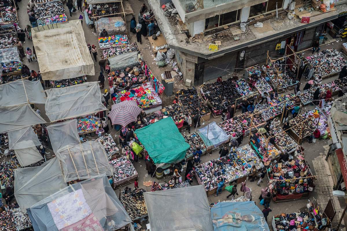 Street vendors sell shoes next at the Al-Attaba market in the centre of the Egyptian capital Cairo on 21 February 2018. [KHALED DESOUKI/AFP via Getty Images]
