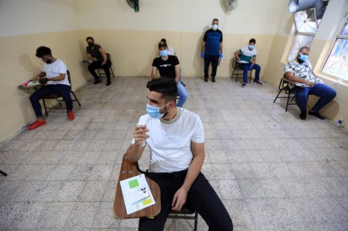 Iraqi students, wearing protective masks, maintain social distancing while taking their final exams amid coronavirus (COVID-19) measures in Baghdad, Iraq on September 01, 2020 [Murtadha Al-Sudani - Anadolu Agency]