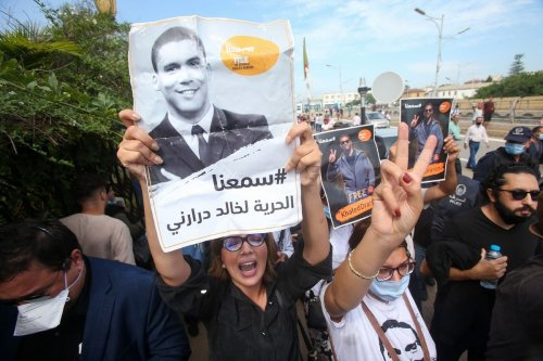 Algerian protesters gather outside court in support of journalist Khaled Drareni in Algiers, Algeria on 15 September 2020 [AFP/Getty Images]