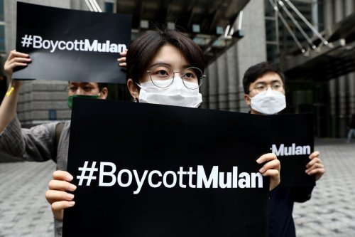 Protesters participate in a rally calling for a boycott of the Disney's live-action remake of 'Mulan' in front of Walt Disney Korea office on 1 July 2020 [Chung Sung-Jun/Getty Images]