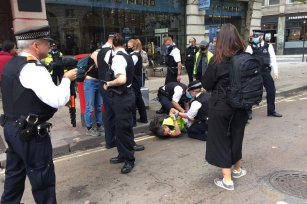 British police can be seen arresting a Palestine Action activist during a protest against Israeli defence company 'Elbit System' in London, UK on 5 September 2020 [Palestine Action]