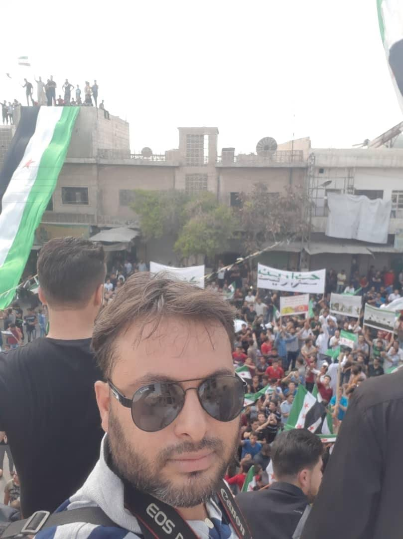 Obaida Al-Omar at a protest in Kafar Nabl, Idlib