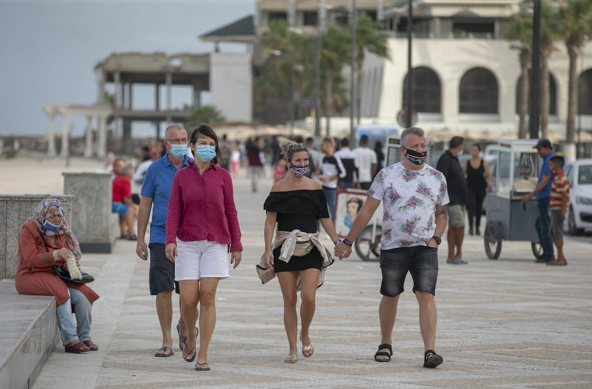 Tunisians and tourists wear masks as a precaution against the Covid-19 pandemic in Soussa, Tunisia on October 05, 2020 [Yassine Gaidi/Anadolu Agency]