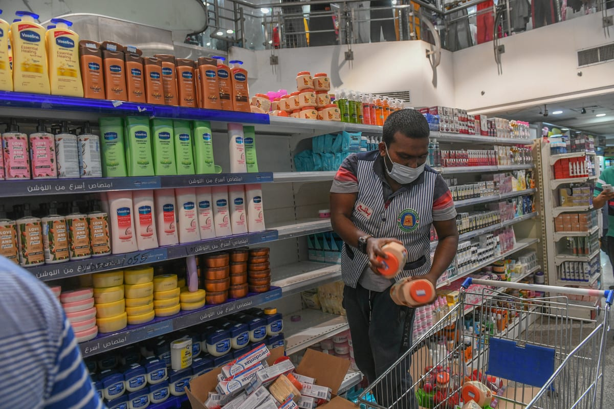 French products are being removed from shelves at a market, boycotting France as a reaction against the republication of offensive caricatures of the Prophet Muhammad in France in Kuwait City, Kuwait on 24 October 2020. [Jaber Abdulkhaleg - Anadolu Agency]