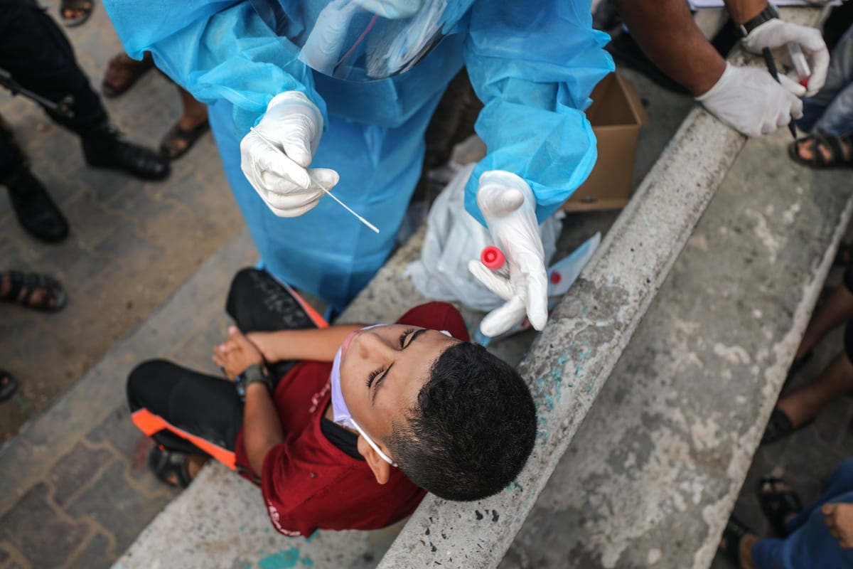 A Palestinian boy is being a tested for COVID-19 in Gaza City, Gaza on 30 October 2020 [Ali Jadallah/Anadolu Agency]