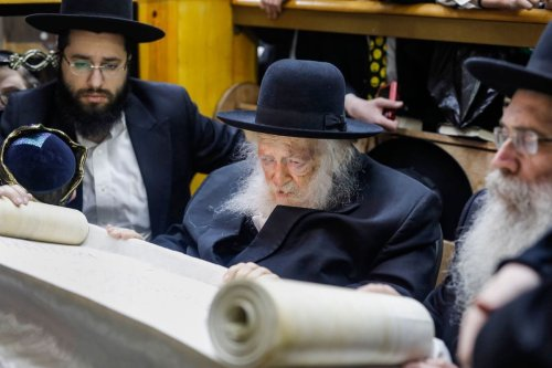 Rabbi Chaim Kanievsky (C), 93-years-old and one of the main spiritual leader of Ultra-Orthodox Jews, reads the book of Esther during the feast of Purim at a synagogue in the Israeli city of Bnei Brak on 20 March 2019. [MENAHEM KAHANA/AFP via Getty Images]