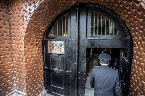 Egyptian police officer entering the Tora prison in the Egyptian capital Cairo, on February 11, 2020 [KHALED DESOUKI/AFP via Getty Images]