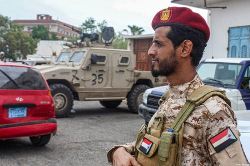 A fighter loyal to Yemen's Southern Transitional Council (STC) stands on guard while deployed at the entrance of Aden International Airport of the southern Yemeni city on 27 August 2020. [SALEH AL-OBEIDI/AFP via Getty Images]