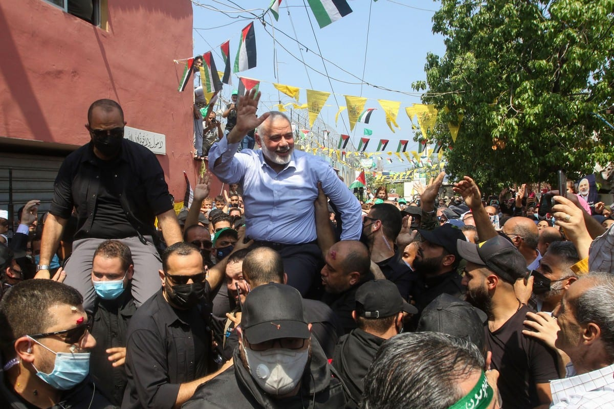 Hamas' political bureau chief Ismail Haniyeh greets supporters during a visit to the Ain el-Helweh camp, Lebanon's largest Palestinian refugee camp, near the southern coastal city of Sidon on September 6, 2020 [MAHMOUD ZAYYAT/AFP via Getty Images]
