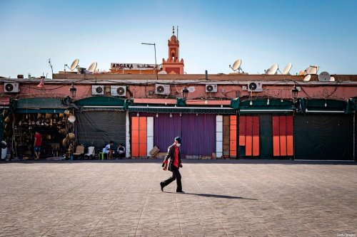 A man walks by mostly-closed stalls at the Jemaa el-Fna square in the Moroccan city of Marrakesh on 8 September 2020, currently empty of its usual crowds due to the COVID-19 pandemic. [FADEL SENNA/AFP via Getty Images]