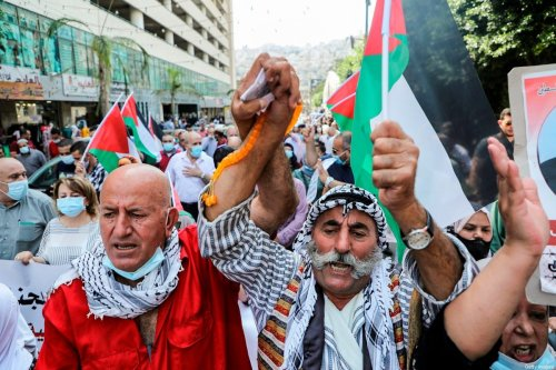 Demonstrators with Palestinian flags during a protest against the United Arab Emirates' and Bahrain's decisions to normalise relations with Israel [JAAFAR ASHTIYEH/AFP via Getty Images]
