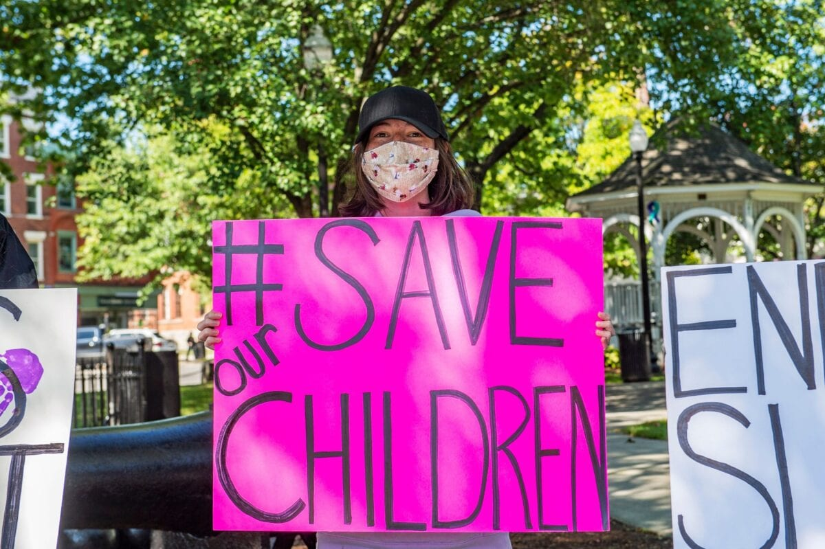 "Demonstrators in Keene, New Hampshire, gather at a ""Save the Children Rally"" to protest child sex trafficking and pedophilia around the world, on September 19, 2020. [JOSEPH PREZIOSO/AFP via Getty Images]"
