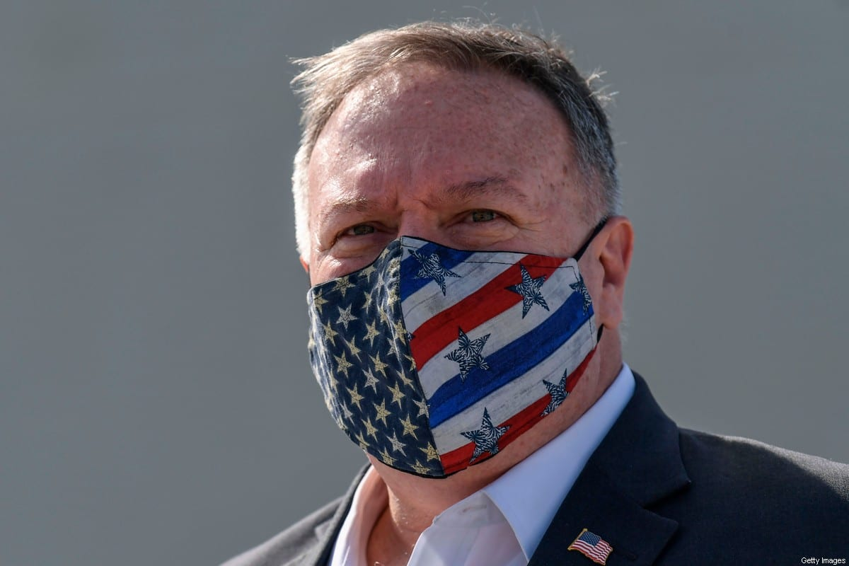 US Secretary of State Mike Pompeo wears a protective face mask as he visits the Naval Support Activity base at Souda, the foremost US naval facility in the eastern Mediterranean on the Greek island of Crete. - US Secretary of State Mike Pompeo on September 29, 2020, concludes a two-day visit to Greece on with a tour of a strategically vital NATO base on a trip aimed at easing tensions between Greece and Turkey in the eastern Mediterranean. (Photo by ARIS MESSINIS / POOL / AFP) (Photo by ARIS MESSINIS/POOL/AFP via Getty Images)