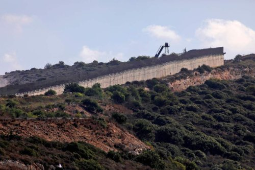 An Israeli military observation point on the border wall separating Israel (L) from Lebanon (R), near the Rosh Hanikra Crossing, also known as the Ras Al Naqoura Crossing on 12 October 2020. [JALAA MAREY/AFP via Getty Images]