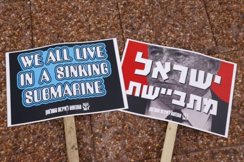 Placards denouncing Prime Minister Benjamin Netanyahu and his handling of the coronavirus pandemic during a demonstration on October 17, 202 [JACK GUEZ/AFP via Getty Images]