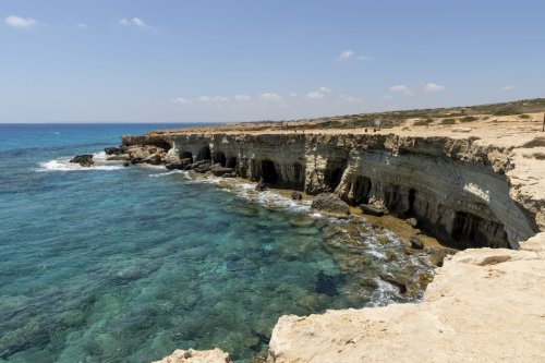 The sea caves with the turquoise waters at Cape Greco on July 17, 2020 in Ayia Napa, Cyprus [Athanasios Gioumpasis/Getty Images]