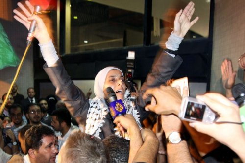 Jordanian freed prisoner Ahlam Tamimi waves as she arrives at Queen Alia international airport in Amman, late October 18, 2011 [LOUAI BESHARA/AFP via Getty Images]