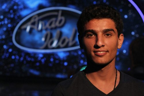 Palestinian performer Mohammed Assaf poses for a picture during a rehearsal for Arab Idol talent show in the Lebanese city of Jounieh north of the capital Beirut, on May 17, 2013. [ANWAR AMRO/AFP via Getty Images]