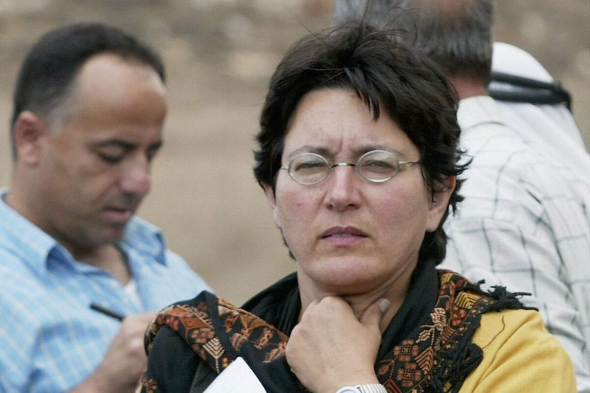 YANUN, WEST BANK: (FILE PHOTO) Amira Hass, an Israeli reporter for the Israeli daily newspaper Haaretz, was awarded June 18, 2004 the first 250 000-kronor ($33 100) Anna Lindh Award for her reporting on Palestinian life in the Israeli-Palestinian conflict. Hass, the daughter of Jewish Holocaust survivors, is seen in this October 21, 2002 file photo while working in the West Bank, and now covers the West Bank from the Palestinian city of Ramallah where she moved in January 1997. The prize is in honour of Lindh, Sweden's foreign minister who was fatally stabbed in September last year. (Photo by David Silverman/Getty Images)