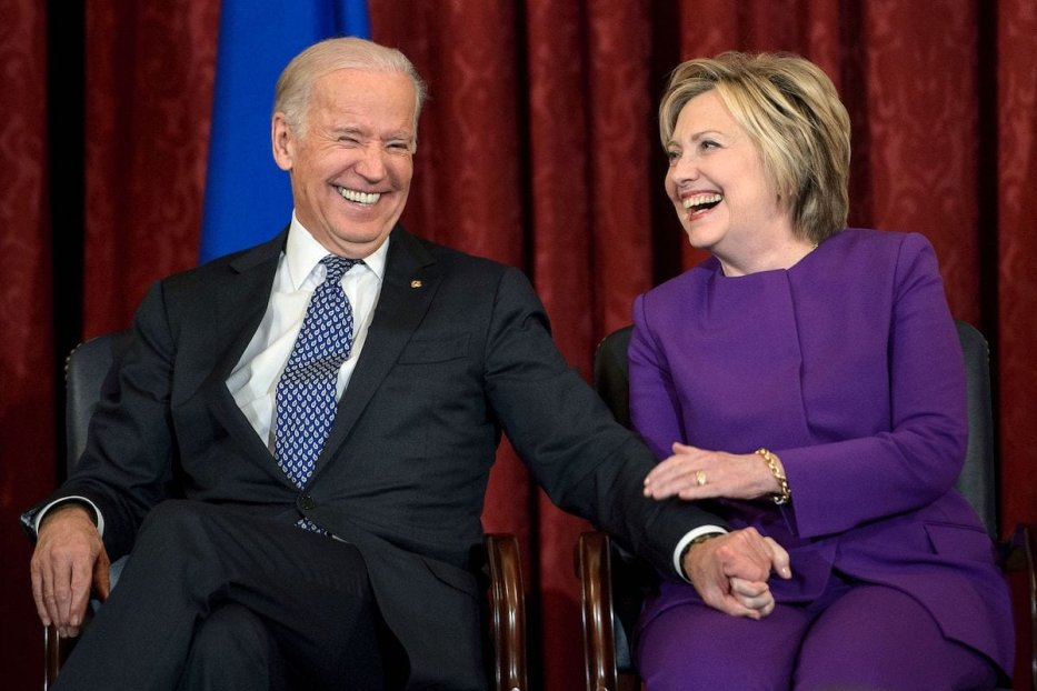Former US Secretary of State, Hillary Clinton shares a laugh with US Vice President Joseph Biden, during a portrait unveiling ceremony for outgoing Senate Minority Leader Harry Reid (D-NV), on Capitol Hill 8 December 2016 in Washington, DC. [Mark Wilson/Getty Images]