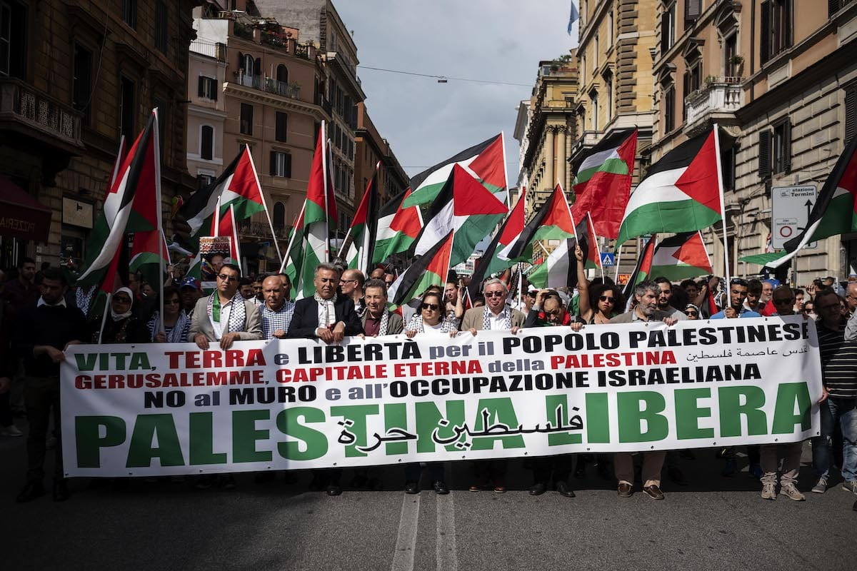 "People hold a banner reading ""Free Palestine"" during a protest in support of the Palestinian cause on May 12, 2018 in Rome, Italy. [Antonio Masiello/Getty Images]"