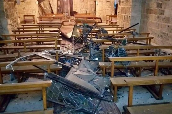 Glass and metal shattered on a church floor after the Beirut blast