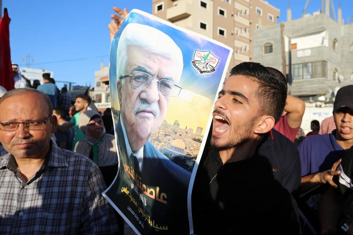 Palestinians carry pictures of Palestinian President Mahmoud Abbas during a protest in Gaza on 20 August 2020 [Ashraf Amra/ApaImages]
