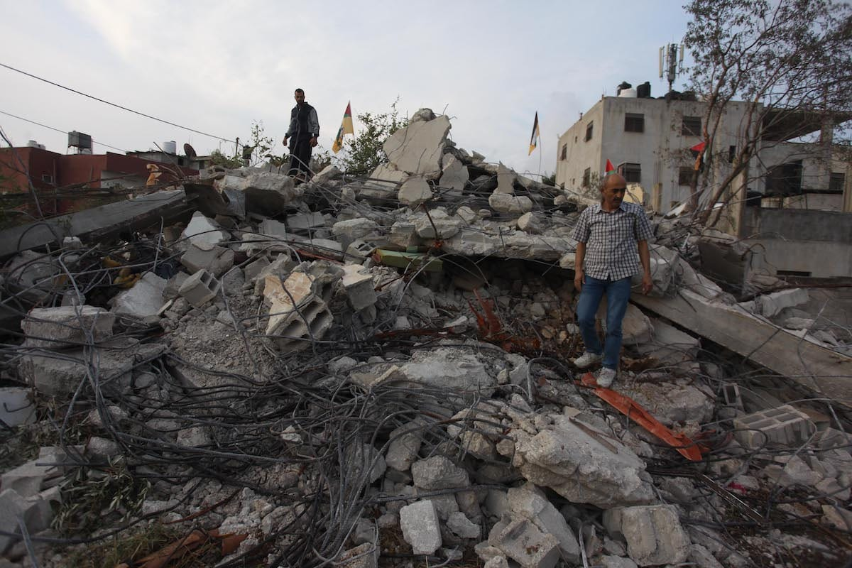Palestinians inspect debris of a Palestinian house demolished by Israeli forces in the West Bank on 2 November 2020 [Nedal Eshtayah/Anadolu Agency]