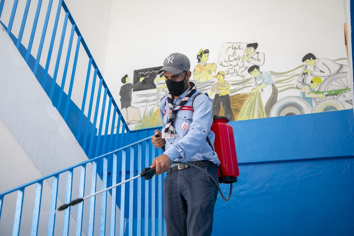 Tunisian scouts carry out disinfection works against coronavirus (Covid-19) pandemic in Tunis, Tunisia on November 11, 2020 [Yassine Gaidi/Anadolu Agency]