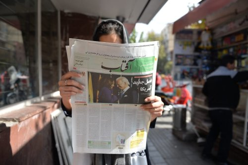 A view from Tehran's street as a citizen reading the news regarding the US elections in newspapers, on November 09, 2020 in Tehran, Iran [Fatemeh Bahrami/Anadolu Agency]