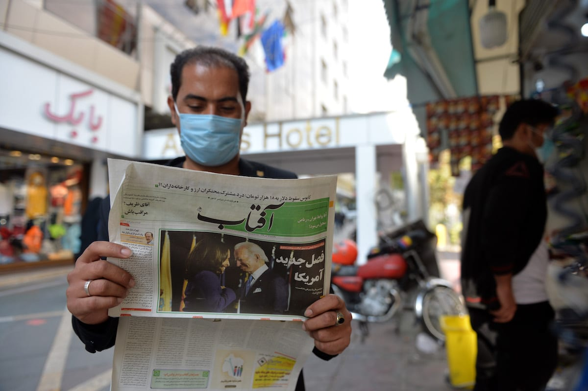 A view from Tehran's street as a citizen reading the news regarding the U.S. elections in newspapers, on November 09, 2020 in Tehran, Iran. The people in Iran seem hopeful that Joe Biden, who won the U.S. Presidential election, lifts the sanctions and that the economy will regain mobility. Iranian people, who have had a difficult times for 2,5 years after Donald Trump left the nuclear deal on May 8, 2018 and imposed sanctions on Tehran on August 7, expect Biden, who won the U.S. elections, to lift the embargoes. ( Fatemeh Bahrami - Anadolu Agency )