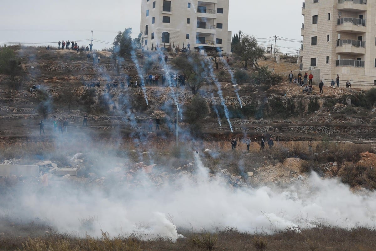 RAMALLAH, WEST BANK - NOVEMBER 11: Israeli forces intervene in Palestinians with tear gas during a demonstration to mark the 16th death anniversary of former Palestinian leader Yasser Arafat in Ramallah, West Bank on November 11, 2020. ( Issam Rimawi - Anadolu Agency )