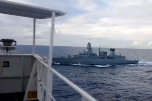 """AT SEA - NOVEMBER 23: (----EDITORIAL USE ONLY – MANDATORY CREDIT - """"MINISTRY OF NATIONAL DEFENCE OF TURKEY / HANDOUT"""" - NO MARKETING NO ADVERTISING CAMPAIGNS - DISTRIBUTED AS A SERVICE TO CLIENTS----) A screen grab captured from a video shows a German frigate serving under a Greek-commanded EU naval mission conducted an hours-long and illegal search on a Turkish cargo ship carrying humanitarian supplies in the Eastern Mediterranean Sea to war-torn Libya, on November 23, 2020. The search reportedly violated international law, which requires a party to obtain the consent of a ship's flag state before searching a vessel, according to the law of the sea. ( TUR National Defence Ministry - Anadolu Agency )"""