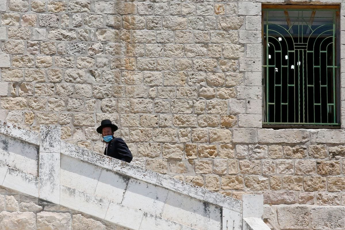 A Jewish worshipper enters the Ibrahimi mosque in the occupied West Bank city of Hebron on 7 August 2020 [HAZEM BADER/AFP via Getty Images]