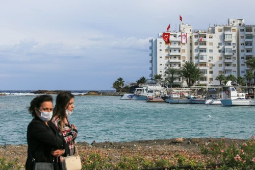 Women walk on November 15, 2020 in the port city of Famagusta near the disputed town of Varosha, in Famagusta, Cyprus. [Alexis Mitas/Getty Images]