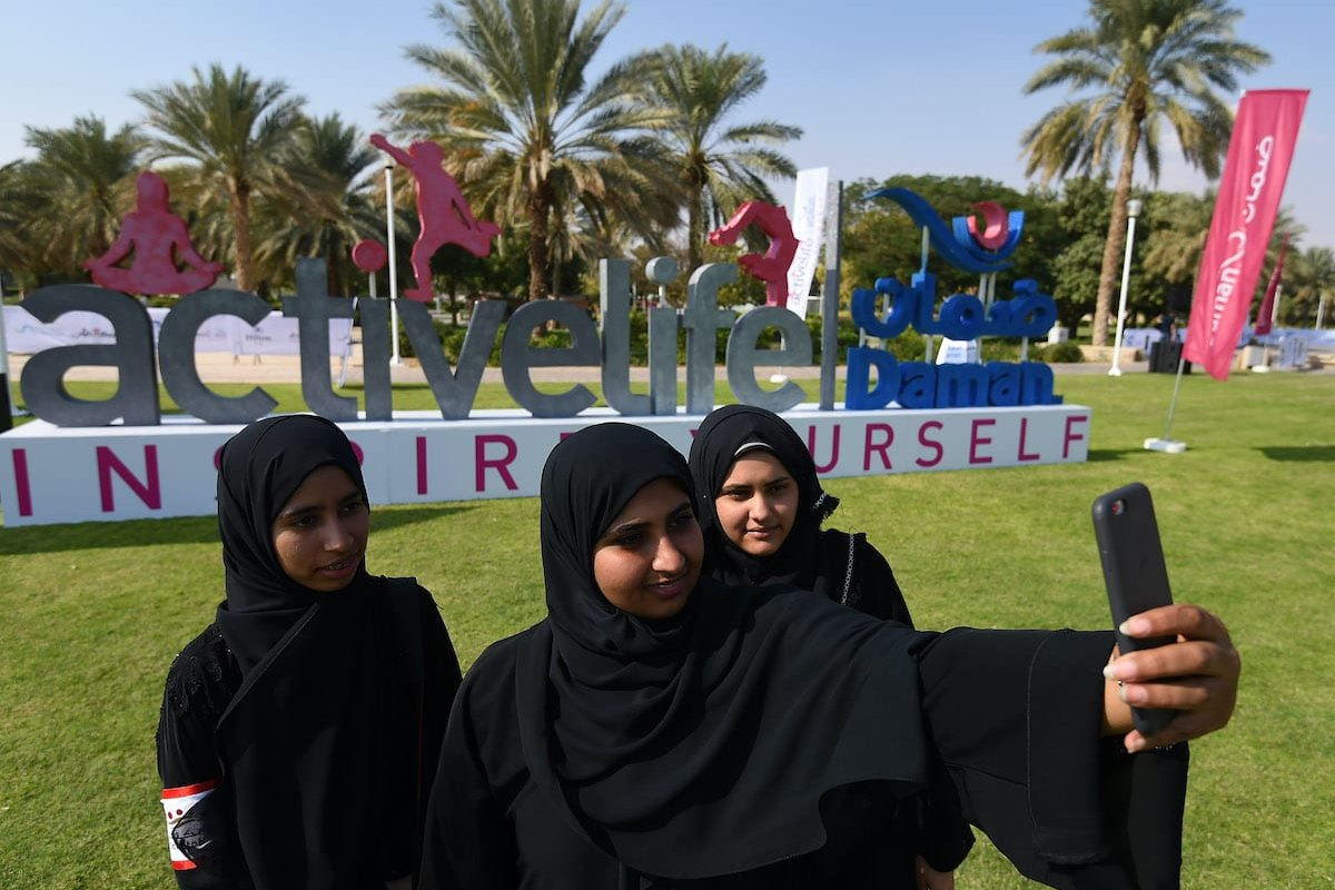 Young girls in Abu Dhabi, UAE on December 3, 2017 [Dulat/Getty Images]