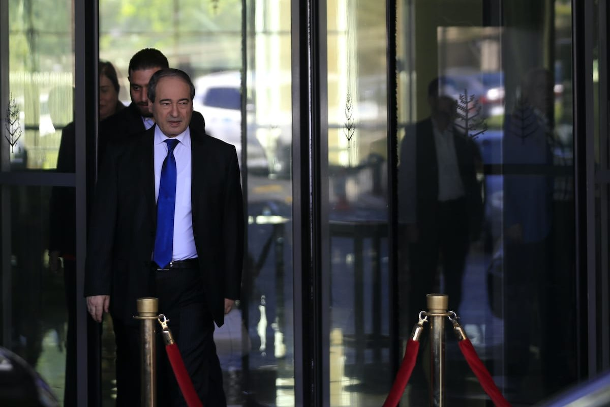 Syrian Deputy Foreign Minister Faisal Mekdad leaves the hotel, where the team of chemichal experts from the Organisation for the Prohibition of Chemical Weapons (OPCW) are residing, on 15 April 2018, in Damascus. [LOUAI BESHARA/AFP via Getty Images]