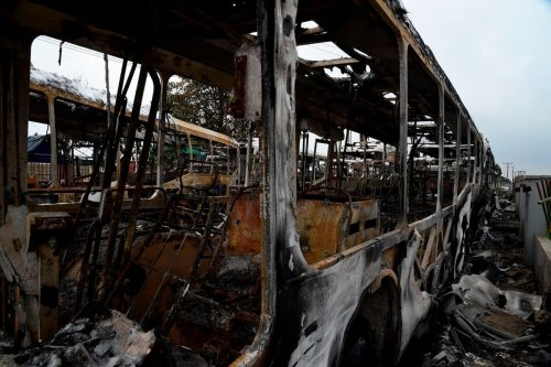 Burnt buses during a protest against police brutality, in Lagos, Nigeria 2020 [PIUS UTOMI EKPEI/AFP/Getty Images]