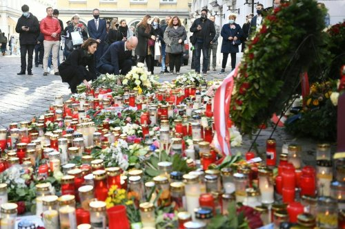 Wreaths and flowers laid after a deadly shooting spree in Vienna, Austria on 5 November 2020 [HELMUT FOHRINGER/APA/AFP/Getty Images]