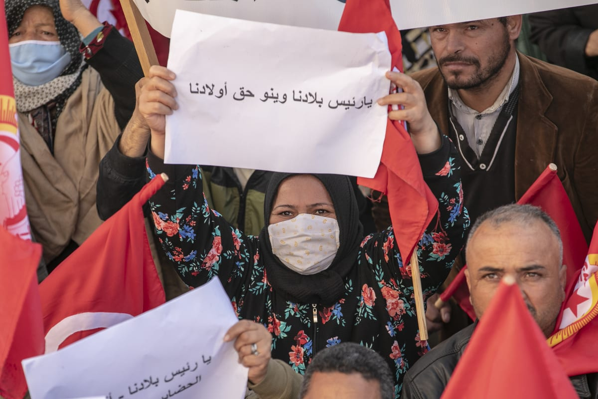Protesters gather upon calling of Tunisian General Labour Union (UGTT) to stage a demonstration demanding that the ministries fulfill their reform promises for the region in Kairouan, Tunis on 3 December 2020. [Yassine Gaidi - Anadolu Agency]
