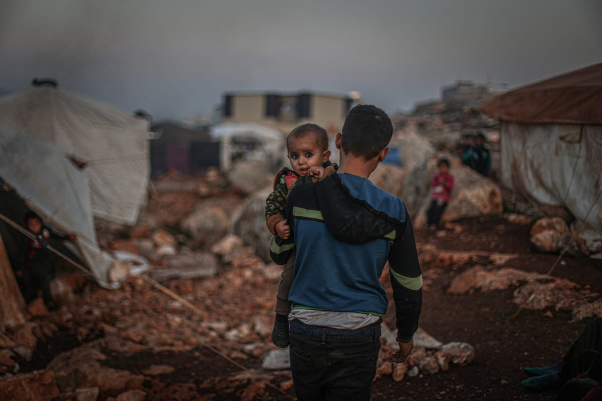 Civilians who fled from the attacks of the Assad regime took refuge in a tent camp in Idlib on December 05, 2020 in Idlib, Syria [Muhammed Said/Anadolu Agency]