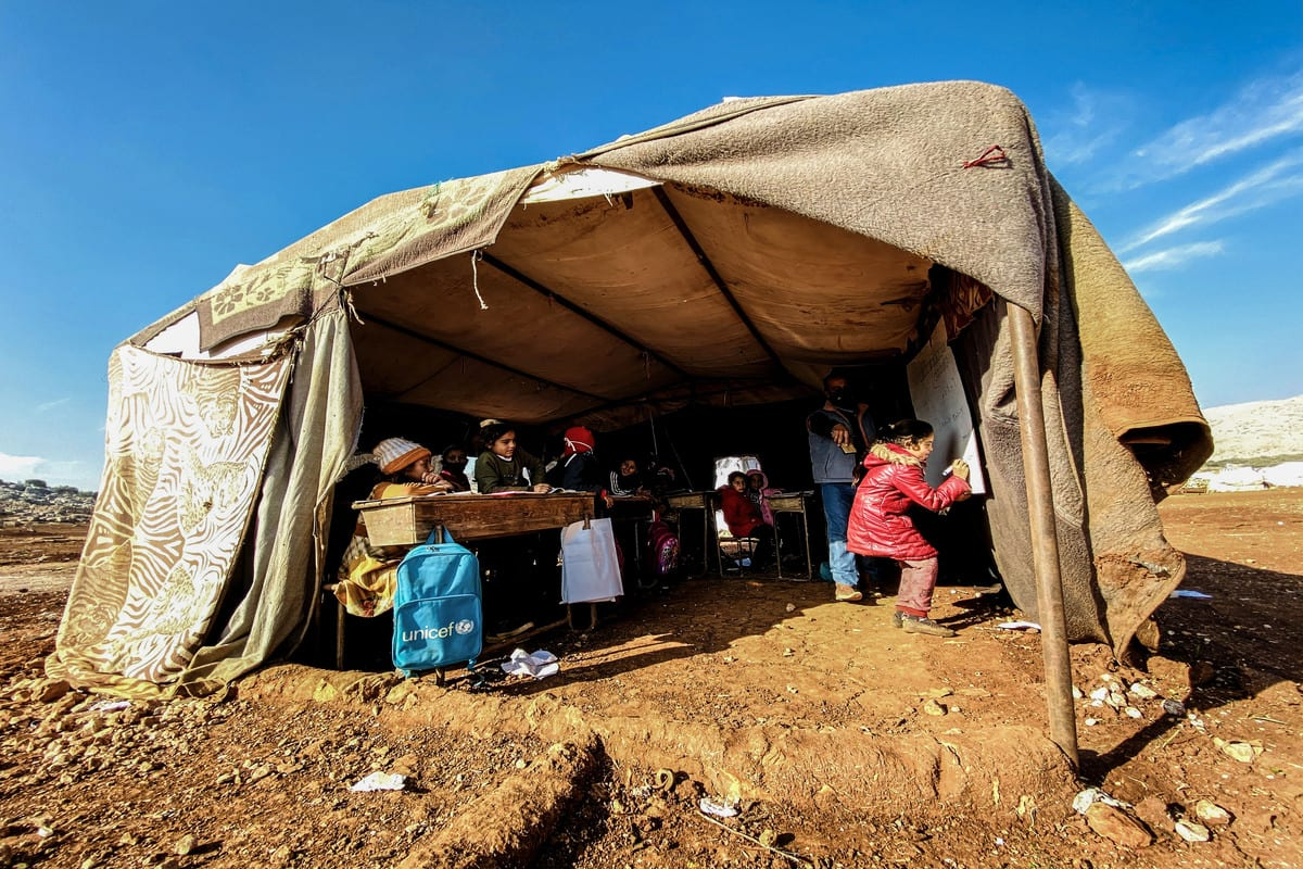 Children have their school lessons inside a tent in Idlib, Syria on 24 November 2020 [Muhammed Abdullah/Anadolu Agency]