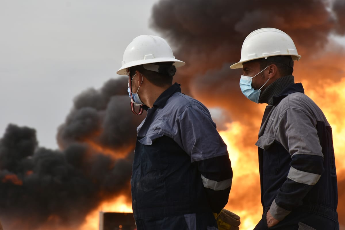 Firefighter teams conduct extinguish works after a bomb attack on an oil field in the Kirkuk, Iraq on 15 December 2020 [Ali Makram Ghareeb/Anadolu Agency]