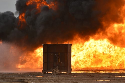 KIRKUK, IRAQ - DECEMBER 15: Smoke rises after the Daesh carried out a bomb attack on wells in the Habbaza oil field in the Kirkuk province of Iraq on December 15, 2020. ( Ali Makram Ghareeb - Anadolu Agency )