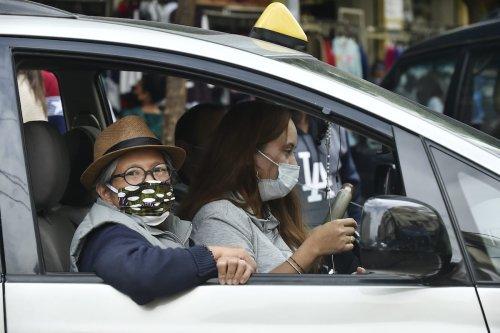 People in face masks as a preventive measure against the coronavirus (COVID-19) pandemic in Beirut, Lebanon on 21 December2020 [Houssam Shbaro/Anadolu Agency]
