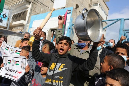 Palestinians gathering in front of the United Nations Agency for Palestinian Refugees (UNRWA) stage a demonstration against reducing UNRWA's services, in Khan Yunis, Gaza on 23 December 2020. [Ashraf Amra - Anadolu Agency]